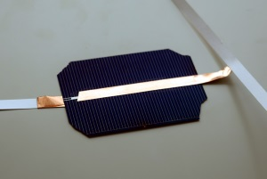 Conductive copper tape connects the front of one cell to back of another.