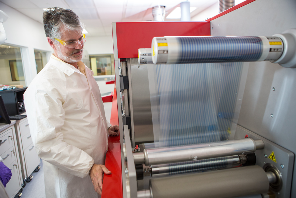 Devin Mackenzie and the roll-to-roll printer at the Testbeds