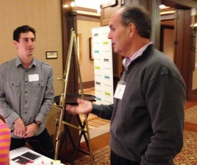 CEI student Dane DeQuilletes talks with Puget Sound Energy executive Phil Bussey