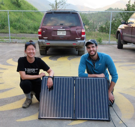 Lauren Kang and Wes Tatum with a recently-installed solar panel.